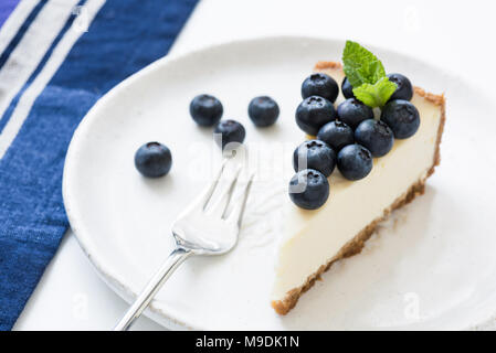Cheesecake with fresh blueberries on white plate. Blueberry cheesecake. Horizontal, selective focus - Stock Photo
