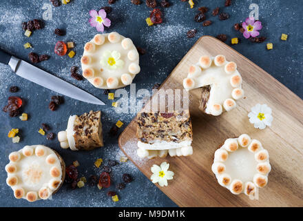 Homemade miniature simnel cakes on slate. - Stock Photo
