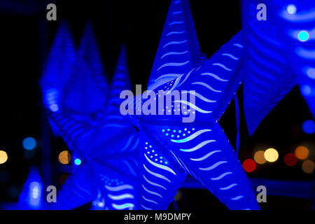 Blue star lights hanging in a park at Waterfire in Providence, Rhode Island. - Stock Photo