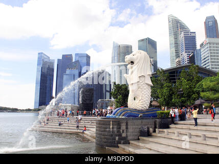 SINGAPORE-MARCH 8, 2018: Merlion statue fountain (of the most famous tourist attraction) in Merlion Park and skyscrapers in Singapore city. - Stock Photo