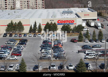 A full costco parking lot on a busy Saturday shopping day - Stock Photo