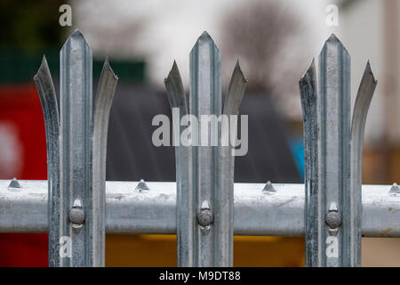 the tops of the uprights on some razor sharp palisade fencing panels for protection and security against crime prevention measures. metal security bar - Stock Photo
