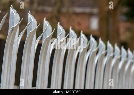 razor sharp palisade security fencing surrounding private property. security measures and fencing for protection and surrounding secure and securing. - Stock Photo