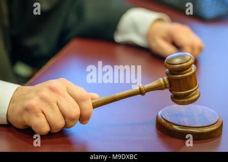 Judge's Hand with Gavel in Courtroom - Stock Photo