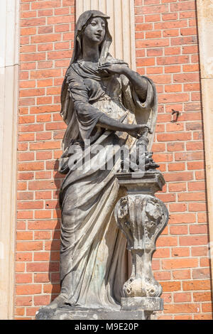 Sculpture near the brick wall of a new Sanssouci Palace. Potsdam. Germany - Stock Photo
