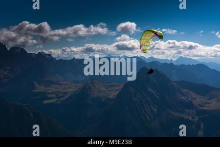 Paragliding, Dolomites, Sella Group, Sass Pordoi, Piz Boe, Fassa Valley, aerial photo, Trentino region, Canazei, Campitello, Northern Italy. - Stock Photo