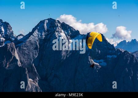 Paragliding, Dolomites, Sella Group, Sass Pordoi, Piz Boe, Fassa Valley, aerial photo, Trentino region,Italy. Mountain Top Paragliders - Stock Photo