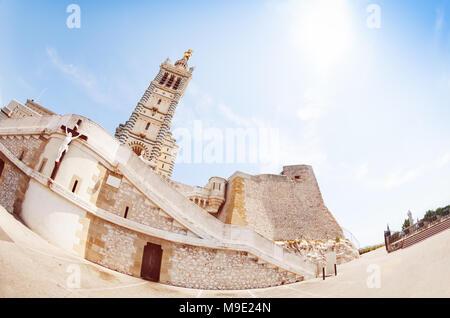 Basilica Notre Dame de la Garde against blue sky - Stock Photo