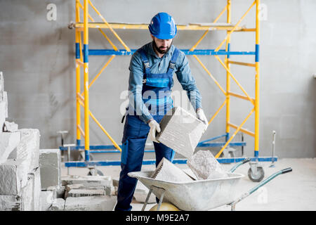 Builder working with blocks indoors - Stock Photo