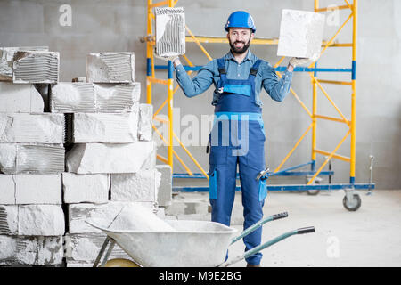 Builder with blocks indoors - Stock Photo
