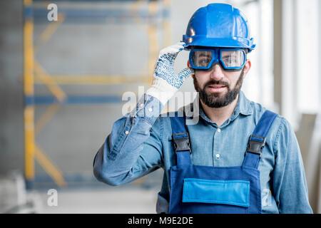 Builder in uniform indoors - Stock Photo