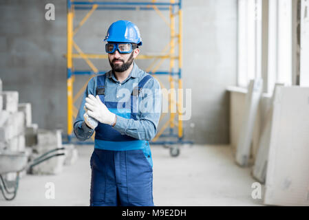 Builder in uniform indoors - Stock Photo