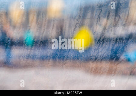 Blurred reflections in a window glass curtained with some plastic cloth - Stock Photo