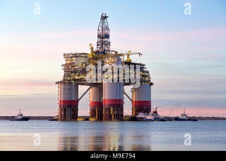 'Big Foot'  Chevron's Deep Ocean Platform departs Kiewit Industries at sunrise, January 30, 2018. - Stock Photo