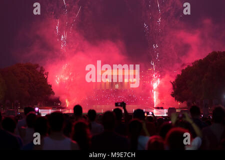 Washington DC, USA - July 04, 2017, The view from Washington monument to the Lincoln Memorial prior and during the 4th of July fireworks display. - Stock Photo