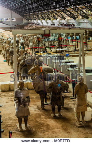 The Terracotta Army was found extensively damaged when discovered in 1974. The warriors have been painstakingly reassembled. Mausoleum of the First Qi - Stock Photo