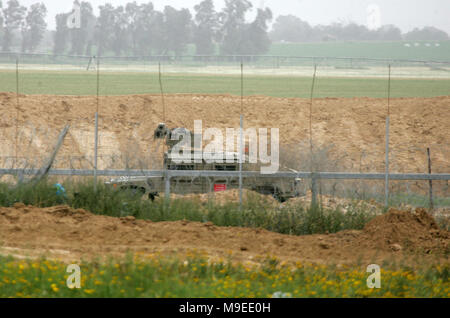 Gaza, Palestinian territories. 23rd march, 2018.   An Israeli military jeep stands next to the border with Gaza, during clashes with Israeli soldiers  - Stock Photo