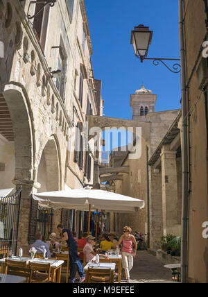 Idyllic restaurant at old town, behind the church Eglise Sainte Marie Majeure, Bonifacio, Corsica, France, Mediterranean, Europe - Stock Photo