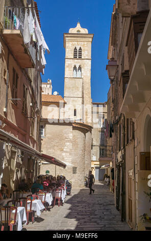 IIdyllic restaurant at church Eglise Sainte Marie Majeure, old town of Bonifacio, Corsica, France, Mediterranean, Europe - Stock Photo