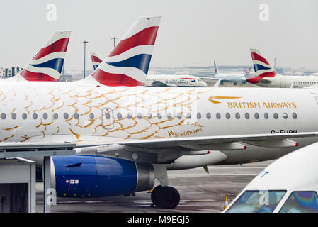 British Airways planes and tailfins at Heathrow Airport, London, England, UK - Stock Photo