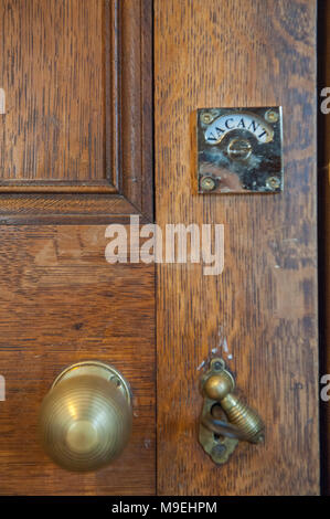 Antique traditional brass door latch and lock on wooden doors ...