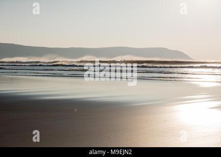 Dusk to Sunset on Woolacombe Beach, North Devon - Stock Photo