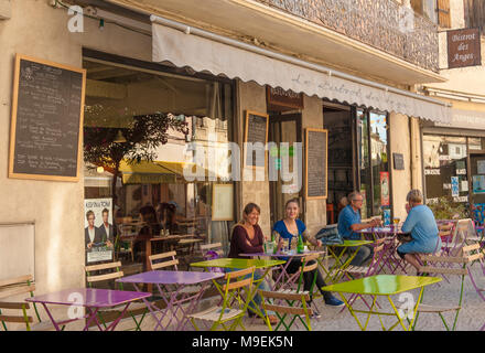 People sitting outside in a café-bar in the old centre of Tarascon, France - Stock Photo