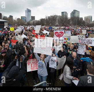 March For Our Lives, Boston, Massachusetts, USA 3-24-2018:  An estimated crowd of over 100,000 People gathered on the Boston Common during the March For Our Lives anti-gun demonstration. March For Our Lives demonstrations took place in most major U.S. cites and around the world on March 24th 2018. March For Our Lives demonstrations were a reaction to the school shooting at Marjory Stoneman Douglas High School on Valentine's Day of 2018 in Parkland Florida, USA.  The shooting in Florida left 17 high school students dead. Credit: Chuck Nacke / Alamy Live News - Stock Photo