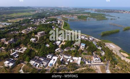 Beijing, China. 24th Mar, 2018. Aerial photo taken on March 24, 2018 shows scenery of Shamei Village in Boao Town, south China's Hainan Province. The Boao Forum for Asia annual conference will take place in Hainan in April, and focus on reform and opening-up. Credit: Guo Cheng/Xinhua/Alamy Live News - Stock Photo