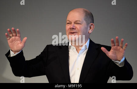 24 March 2018, Germany, Hamburg: Finance Minister Olaf Scholz of the Social Democratic Party (SPD) reacts to the applause he receives after his speech at a special regional meeting of his party. Photo: Daniel Reinhardt/dpa - Stock Photo