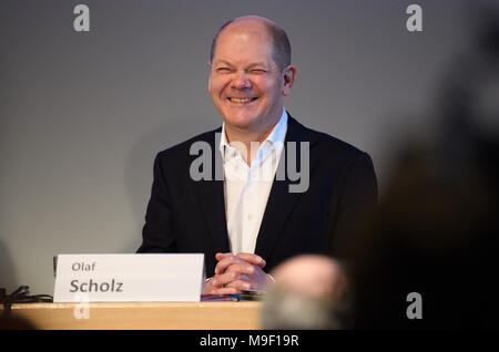 24 March 2018, Germany, Hamburg: Finance Minister Olaf Scholz of the Social Democratic Party (SPD) reacts to the applause he receives after giving a speech at a special regional meeting of his party. Photo: Daniel Reinhardt/dpa - Stock Photo