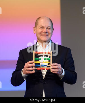 24 March 2018, Germany, Hamburg: Finance Minister Olaf Scholz of the Social Democratic Party (SPD) holds his farewell gift, a slide rule, after leaving his position as mayor at a special regional meeting of his party. Photo: Daniel Reinhardt/dpa - Stock Photo