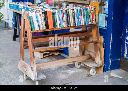 Books on an Old fashioned book trolley bookshop, bookstore with crates of secondhand books outside , London UK book display reading concept education - Stock Photo