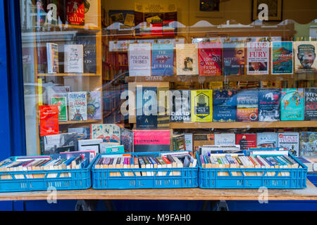 Primrose Hill Books, Old fashioned bookshop, bookstore with crates of secondhand books outside stacked, London UK window book display, window display, - Stock Photo