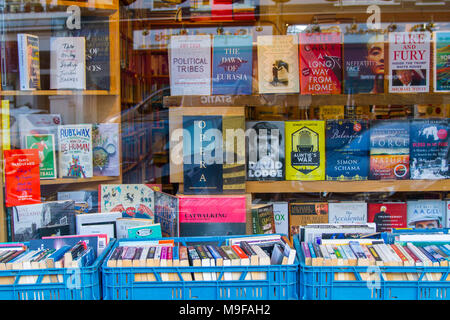 Primrose Hill Books, Old fashioned bookshop, bookstore book shop with crates of secondhand books outside stacked, London UK window book display learn - Stock Photo