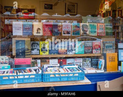 Primrose Hill Books, Old fashioned bookshop, bookstore with crates of secondhand books outside stacked, London UK window book display reading concept - Stock Photo