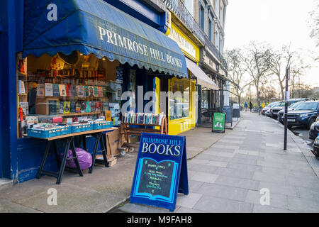 Primrose Hill Books, traditional bookshop, bookstore book shop with crates of secondhand books outside stacked, London UK learning knowledge education - Stock Photo