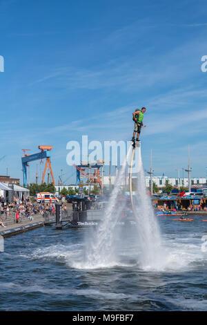 Flyboarder auf Wasserstrahl-Rückstoß, Jetski im Bootshafen, Kieler Woche (Gem. Kiel) am 20.06.2017 - Stock Photo