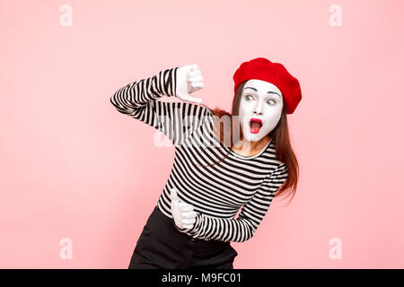 No way! Shocked woman with surprised face look away. Clown, artist , mime. Studio shot, pink background - Stock Photo