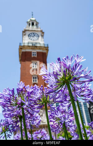 Buenos Aires Argentina Retiro Torre Monumental Torre de los Ingleses clock tower Palladian style architecture park garden flowers Argentinean Argentinian Argentine South America American - Stock Photo