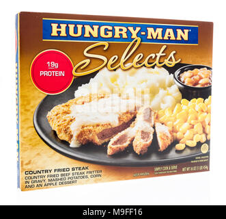 Winneconne, WI - 21 March 2018: A box of Hungry Man selects meal in country fried steak on an isolated background. - Stock Photo