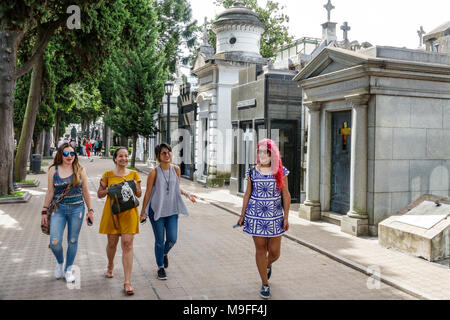 Buenos Aires Argentina Cementerio de la Recoleta Cemetery historic tombs statues mausoleums woman young adult friends pathway Hispanic Argentinean Arg - Stock Photo