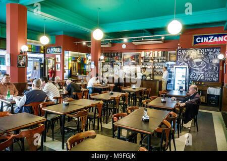 Buenos Aires Argentina Microcentro Mercado del Centro Cafe Bar restaurant interior casual dining tables man Hispanic Argentinean Argentinian Argentine South America American - Stock Photo