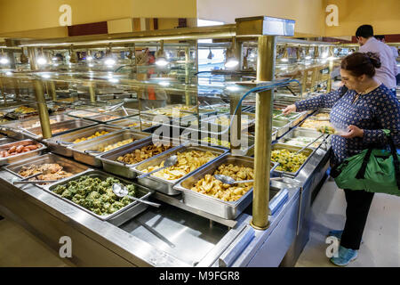 Buenos Aires Argentina Microcentro Restaurant Pekin Comida de China restaurant interior Asian food buffet self-serve chafing trays sneeze guard food safety woman Hispanic Argentinean Argentinian Argentine South America American - Stock Photo