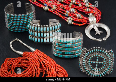 Collection of Native American Turquoise, Silver and Coral Bead Jewelry. Cuff Bracelets and Bead Necklaces. - Stock Photo
