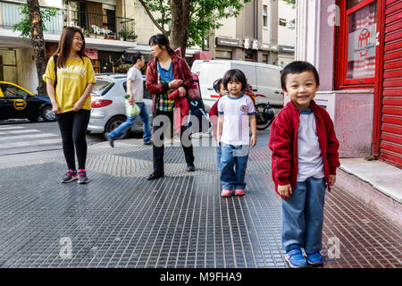 Buenos Aires Argentina Belgrano China Town Barrio Chino Chinatown ethnic neighborhood Asian boy girl child preschooler sibling brother sister walking - Stock Photo