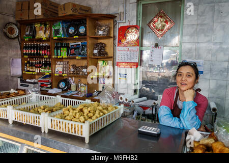 Buenos Aires Argentina Belgrano China Town Barrio Chino Chinatown ethnic neighborhood Asian food vendor kiosk woman Hispanic Argentinean Argentinian A - Stock Photo