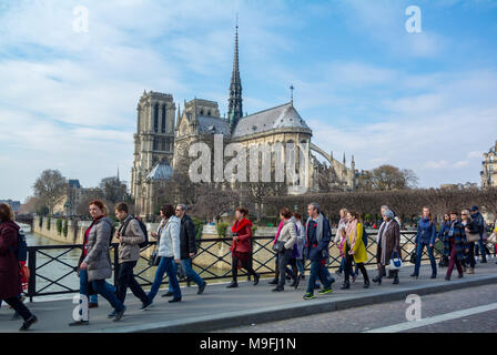 tourists by notre dame cathedral, Paris, France - Stock Photo