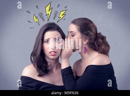 A beautiful girl in black dress sharing secrets to her girlfriend