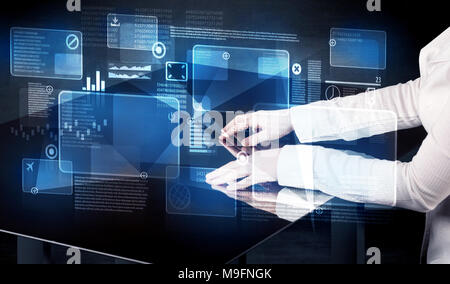 Man pressing technology smart table interface with blue graphs - Stock Photo